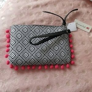 American Eagle wristlet with pink pompom t…